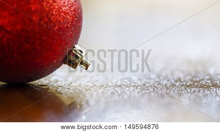 Glittering red Christmas decoration bauble ball - template card banner background
