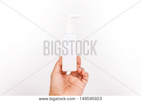 Man hand holding a cream tubepump cream on white background