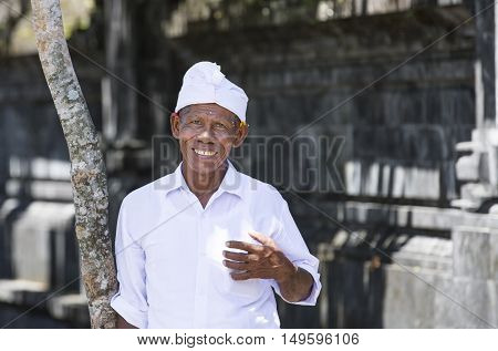 Bali Indonesia September 9th 2016: Indonesian man near a temple smiling