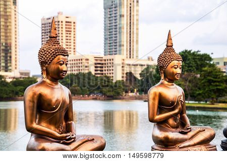 Buddhist sculptures at Seema Malaka temple on Beira Lake. Colombo, Sri Lanka