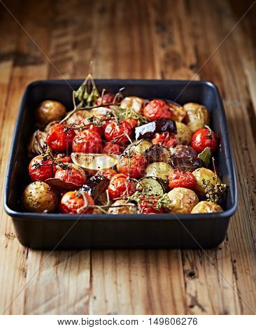 Oven-roasted autumnal vegetables with herbs and lemon