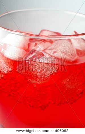 Glass Of Red Drink With Ice Closeup (2)