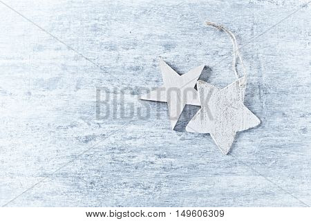 Wooden Christmas stars on a rustic background