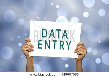 DATA ENTRY card in hand with abstract light background. Selective focus. poster