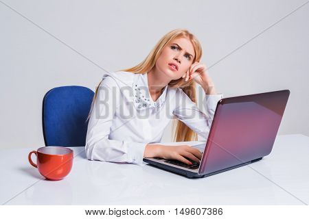 Young businesswoman working at laptop computer. tired girl soon fell asleep stress