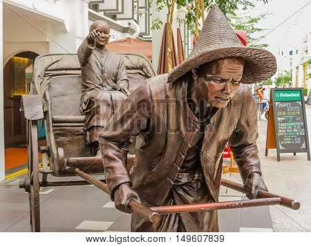 SINGAPORE, REPUBLIC OF SINGAPORE - JANUARY 09, 2014: Sculptures of Chinese rickshaw in the Telok Ayer area, Singapore