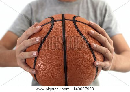 Basketball ball in hands. Selective focus on ball.