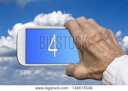 Smart phone in old hand with number FOUR on screen. Selective focus