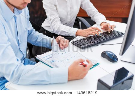 man and woman discussing an office job