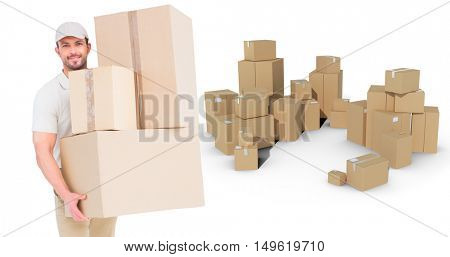 Delivery man carrying cardboard boxes against stack of cardboard box on white background