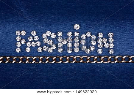 Word FASHION made by with rhinestones and gold chain can be used as background