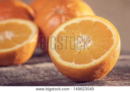 Orange fruit on wooden background. Selective focus.