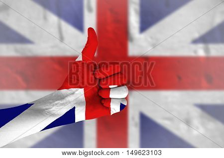 Hand covered in flag of United Kingdom