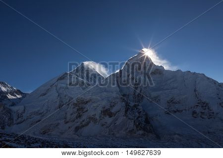 Mount Everest Peak (sagarmatha, Chomolungma). First Rays Of The Sun Coming Up Behind The Nuptse Moun