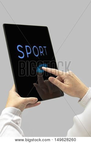 Sport message on digital tablet computer display. Woman hands with tablet computer. Selective focus.