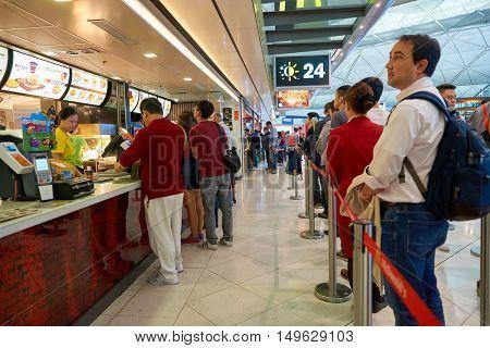 HONG KONG - CIRCA SEPTEMBER, 2016: McDonald's in Hong Kong International Airport. McDonald's is the world's largest chain of hamburger fast food restaurants.