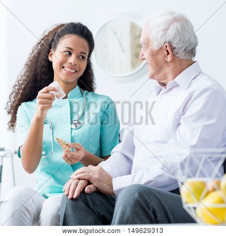 Doctor Caring About Elder Person