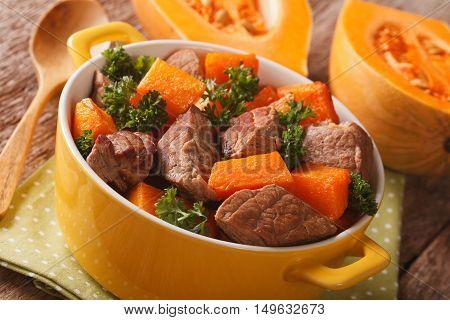 Homemade Food: Beef Stew With Pumpkin Closeup In The Yellow Pot. Horizontal