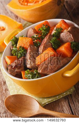 Braised Beef With Pumpkin Closeup In The Pan. Vertical