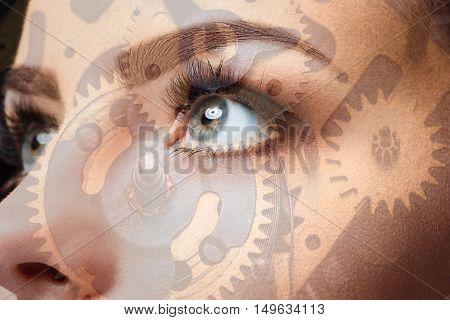 Photo of woman eye and clockwork. The double exposure