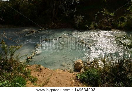 Thermal hot springs with flowing water at Saturnia Italy.