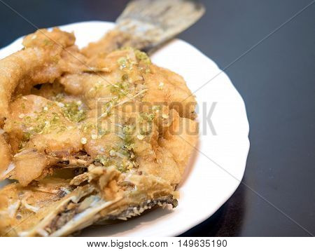 Fish Dishes.Deep fried red snapper topped with sweet fish sauce. Traditional thai cuisine.