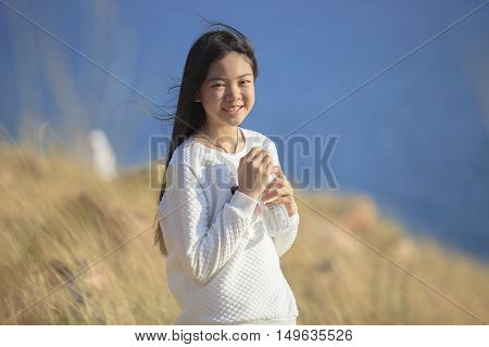 portrait toothy smiling face of asian girl relaxing emotion outdoor lifestyle