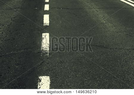 White grunge line on the asphalt road.