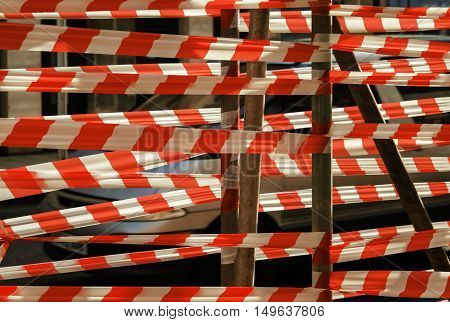 Red and white danger tape on scaffolding.