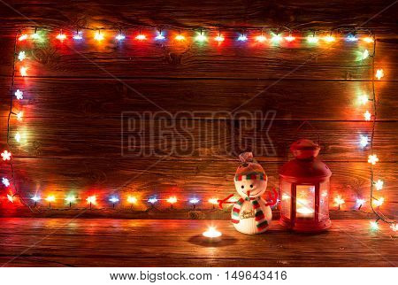 Christmas Lights And Vintage Lantern On Wooden Background.