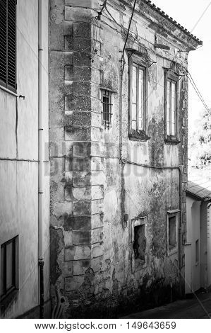 Dramatic View With Black And White Old Building Frame. Vertical Fragment From Ancient Building With