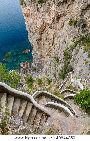 Vertical View Over High Stairs In Amalfi Coast In Italy. Lying At The Mouth Of A Deep Ravine, Amalfi