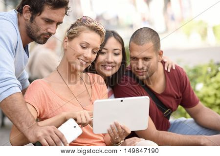 Young people websurfing on digital tablet to find apartment