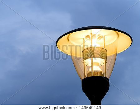 The LED lamp on the electricity pole with the blue sky. The environment conservation by using LED street lamp