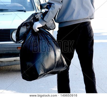 Cropped image of environmental activists collecting garbage