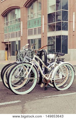 Bicycles parked in a bike rack along the Hudson River waterfront in New Jersey.