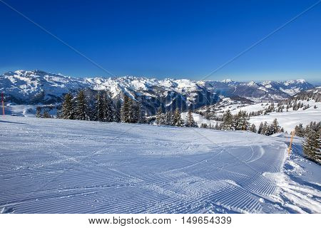 Ski slopes Lake Lucerne and Swiss Alps covered by fresh new snow seen from the Spirstock peak in Hoch-Ybrig ski resort Central Switzerland