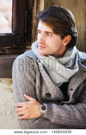 Appealing young man portrait looking at the window