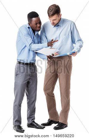 African-American and Caucasian businessman discussing a contract and a quarrel on a white background. a disadvantage