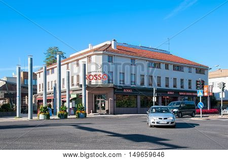 IMATRA, FINLAND - SEPTEMBER 13, 2016: Rosso Resturant Building on Koskenparras and transport on Tainionkoski Road