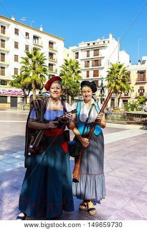 ALGECIRAS, SPAIN - SEPTEMBER 24: Two ladies in corsair costume with guns at the Plaza Alta in Algeciras, Spain on September 24, 2016.