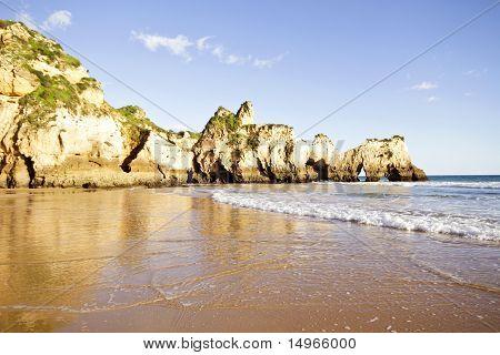 Rocks and ocean at Praia Tres Irmaos in Alvor Portugal