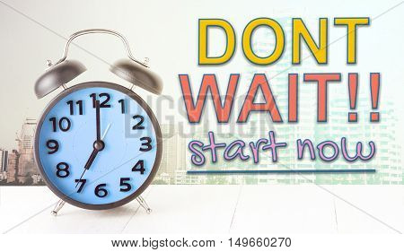 Dont wait start now text with blue alarm clock