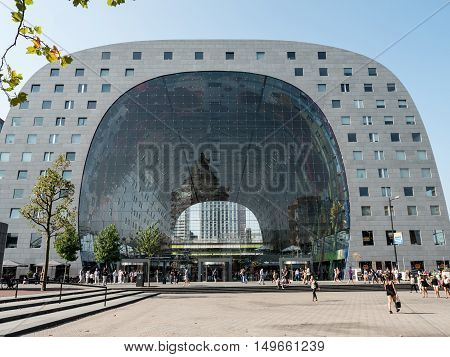 ROTTERDAM, NETHERLANDS - 15 SEPT. 2016: View on exterior of colorful and artisctic Markthal in Rotterdam. The markthal with shops and stalls is also a residential building and was opened in 2014