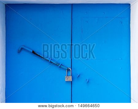 latch and lock on a wooden blue door