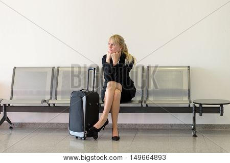 Bored Businesswoman Waiting For A Flight