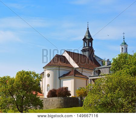 Church of St. Benon in Warsaw city, Poland - view at old town from Visla river