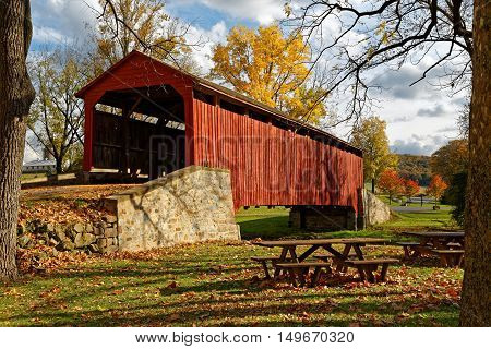 Pool Forge covered bridge in Fall Lancaster County Pennsylvania USA.