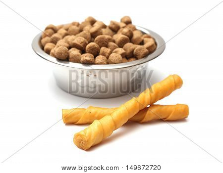 Dog Chew Toys And A Bowl Of Dog Food
