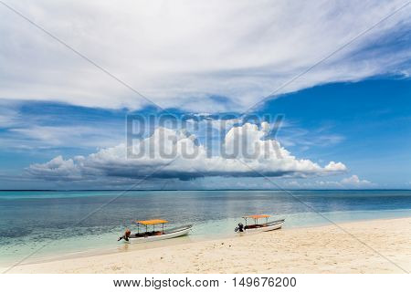 Two fisherman boats on the beach.Tropical seascape, Zanzibar Island, Tanzania